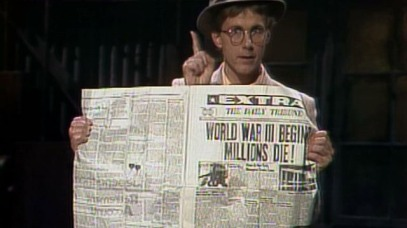Harry Anderson, funniest magician ever. Three hands and holding newspaper.